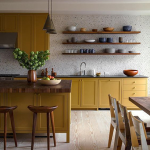 These yellow cabinets help to brighten the kitchen.