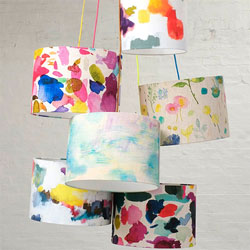 Five brightly coloured patterned lampshades
