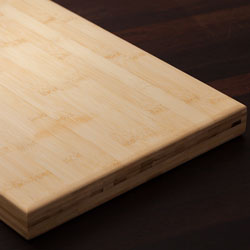 A solid bamboo chopping board