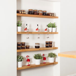Four floating shelves with condiment jars, decorative elements and potted plants