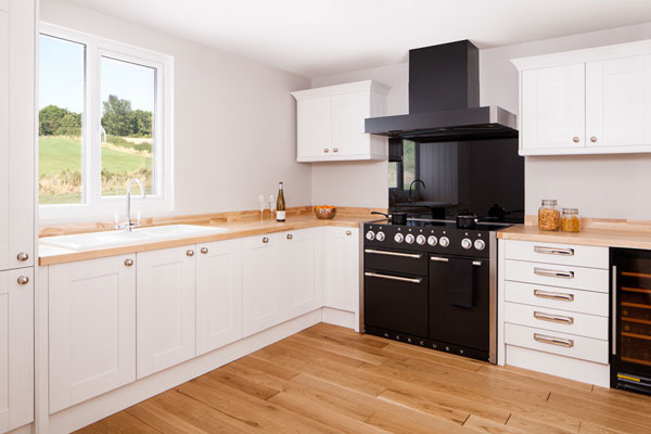 This white kitchen featuring solid wood worktops is a stylish, contemporary option that is perfect for a modern home