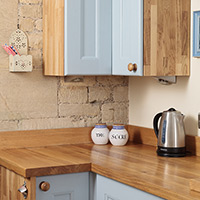 Corner wall units provide handy additional storage space in solid wood kitchens