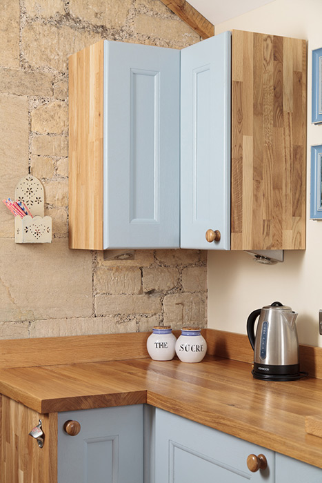 combining base, wall and full-height units in solid oak kitchens