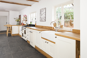 Large family painted with cabinets painted in Farrow & Ball's Wimborne White.
