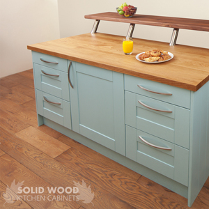An oak kitchen island with solid oak kitchen cabinets painted in blue ground.