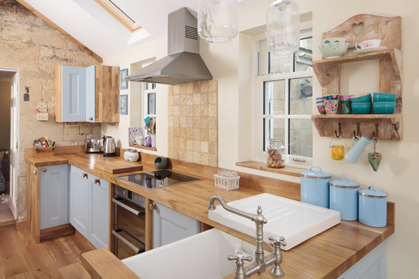 The exposed stonework in this kitchen combines beautifully with Traditional frontals in Farrow & Ball's Lulworth Blue