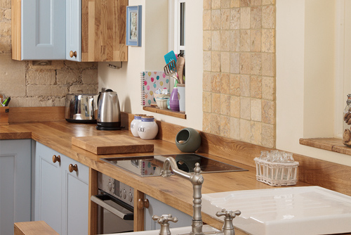 The exposed stonework in this kitchen combines beautifully with Traditional frontals in Farrow & Ball's Lulworth Blue.