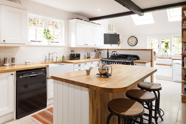 This farmhouse style design features traditional frontals in Farrow & Ball's All White in a monochrome scheme for a modern twist on a traditional look