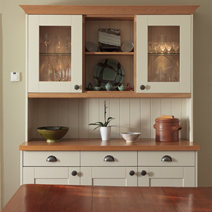 Farrow & Ball's Lime White provides a beautiful finish to these Shaker-style wood cabinets.