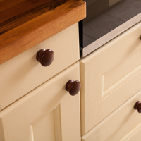 Farrow's cream oak kitchen doors with walnut knobs