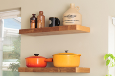 Floating kitchen shelves displaying an array of kitchenware.