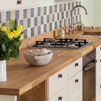 Flowers on an oak worktop with shaker cabinets