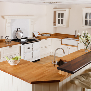 For an even more ornamental look in oak kitchens, frame your splashback with a surround.
