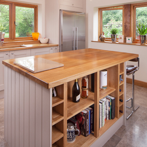 Lacquered open units are a great way to make a feature of crockery and recipe books solid oak kitchen cabinets.