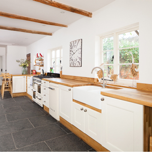 Full stave oak worktops with Wimborne White painted solid oak kitchen cabinets.