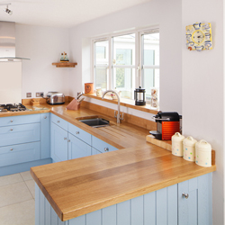 Full stave prime oak worktops with solid oak kitchen cabinets painted in Lulworth Blue.