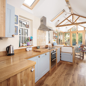 Full stave prime oak wooden worktop with Blue Ground solid oak kitchen cabinets.