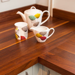 A full-stave worktop with a colourful teapot and mug.