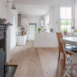 Removing the wall between the kitchen and dining area in this home has really opened up the space, giving the galley kitchen design a much larger look