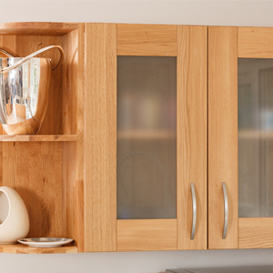 Shiny objects and glass cabinet fronts create depth in solid wood kitchens.