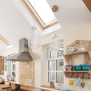 Glass light fittings in solid wood kitchens.