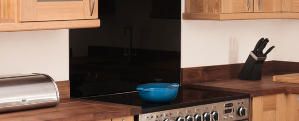 SA sleek, black splashback is a fantastic option for a contemporary kitchen