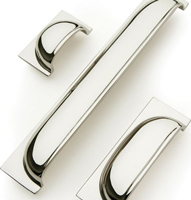 Queslett cup handles for drawers with a polished nickel finish.
