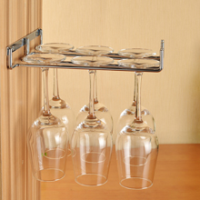 Invest in a hanging glasses rack to free up much needed cupboard space in oak kitchens