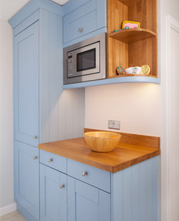 Solid oak microwave housing cabinets help keep work surfaces clear in solid wood kitchens