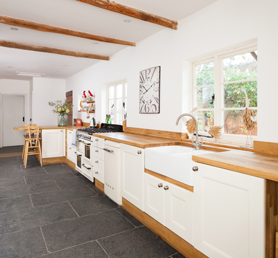Solid full stave oak worktop and oak kitchen cabinets painted in Farrow & Ball's Wimborne White.