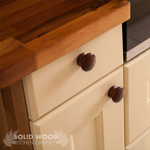 Solid walnut worktop with Farrow's Cream traditional cabinet doors.