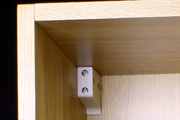 How to Fit a Kitchen: Hook the wall cabinets onto the brackets