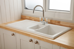This inset ceramic sink is beautifully complemented by the delicate and pale grain of our solid ash worktops.