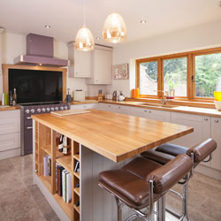 This kitchen features ample space for food preparation on its solid oak worktops whilst also providing an area for people to sit