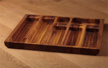 Solid iroko cutlery drawer trays.