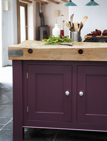 Kitchen island unit painted in Farrow & Ball's Brinjal.