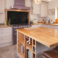 This kitchen island provides additional worktop space along with a stylish seating area.