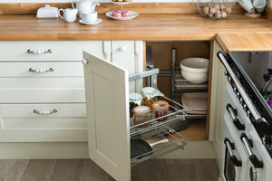 Kitchen wirework provides an elegant storage solution for solid oak kitchens.