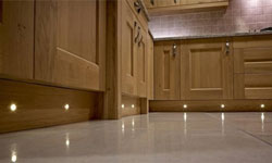 A traditional oak kitchen with plinth lighting