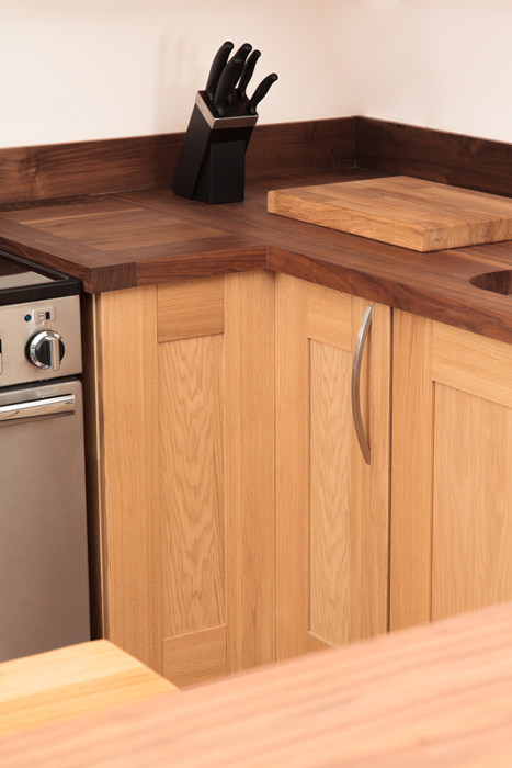 this lacquered l shaped corner base cabinet helps maximise the storage