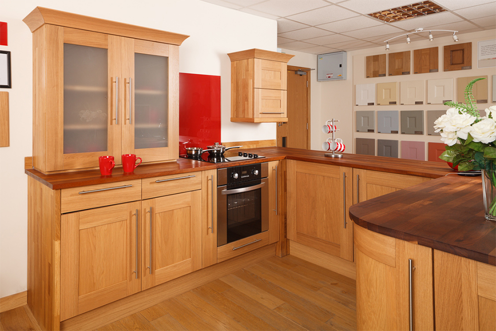 A Lacquered Oak Kitchen With Shaker Frontals And A Glossy Red Splashback.