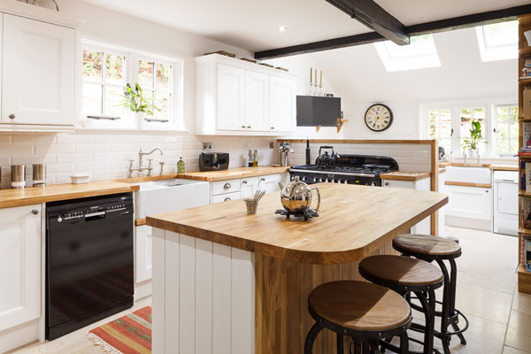 This large kitchen island provides a fantastic space for drinks and snacks,and also has the added bonus of seating.