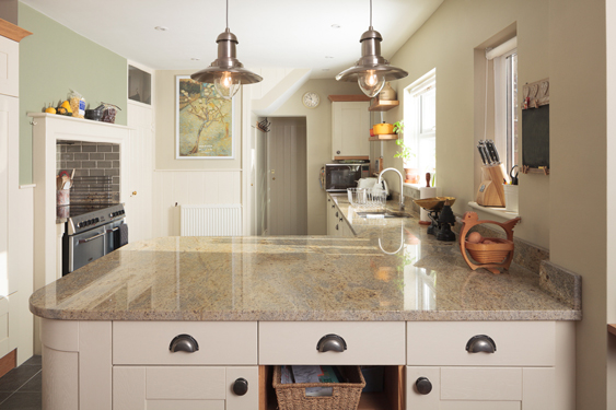Warm Lime White by Farrow & Ball brings warmth to these Venetian gold granite tops.