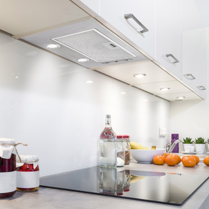 integrated cooker hoods are very discreet and form an unobtrusive element of a kitchen design
