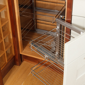 Magic Basket Corner Solution Pull-Out wirework makes it easy to access items in hard-to-reach corners for solid oak kitchens.
