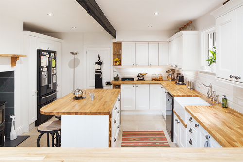 A modern solid oak farmhouse kitchen in All White with gloss white subway tiles