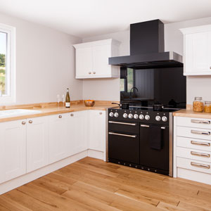 This modern white wood kitchen is perfectly complemented by black appliances and polished chrome cabinet hardware