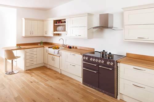 A kitchen with New White Shaker frontals and a full stave prime oak worktop.