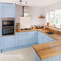 These oak cabinet frontals painted in Farrow & Ball's Lulworth Blue are a great choice for a retro solid wood kitchens makeover.