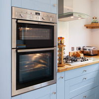Oak kitchen with full height oven housing cabinets